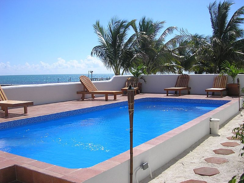 Caribbean Waterfront Condo Overlooking The Barrier Reef.  Pool, Hot Tub, Wifi, holiday rental in Caye Caulker