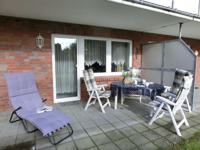 Liebenswerte Ferienwohnung mit Terrasse in Harlesiel, holiday rental in Carolinensiel