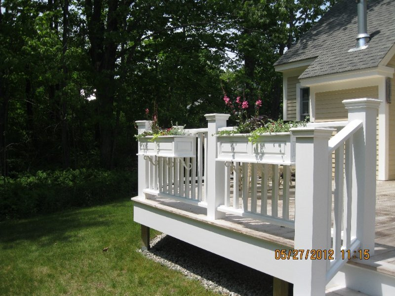 Private and comfortable outdoor deck. Perfect for lounging and dining.