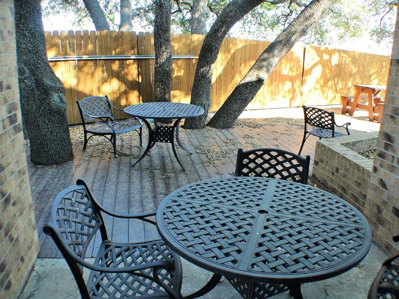 Well shaded resting area next to pool and club house