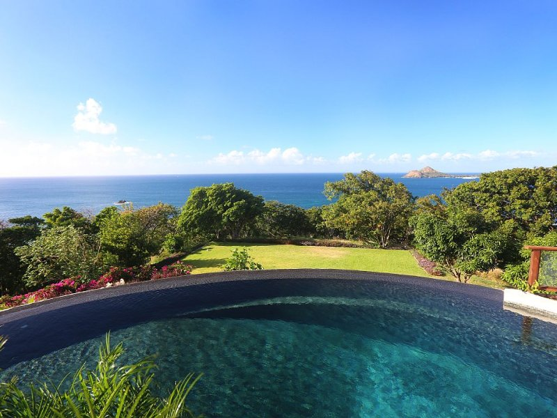 Water views on 3 sides of the swimming pool and St Lucia's largest croquet lawn