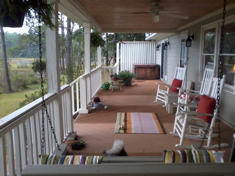 full porch with hot tub on marsh side of house