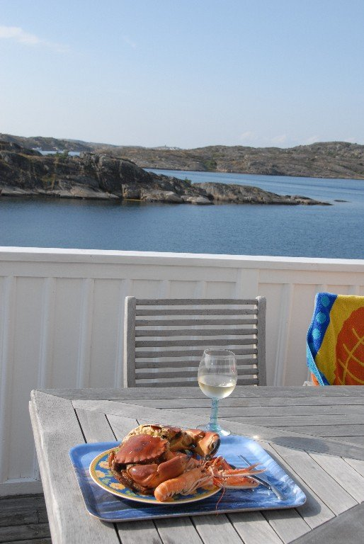 Enjoy a glass of wine and some shellfish treats on the veranda.