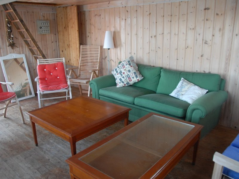 Inside the boat house, cozy. Put the furniture on the dock for a shrimp party.
