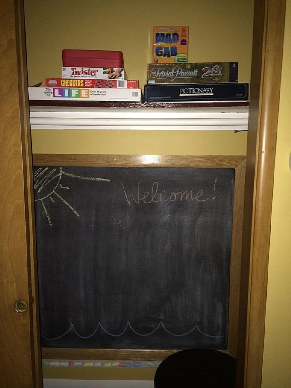 Chalkboard/games: Life, checkers, Twister, Mad Gab, Trivial Pursuit, Pictionary.