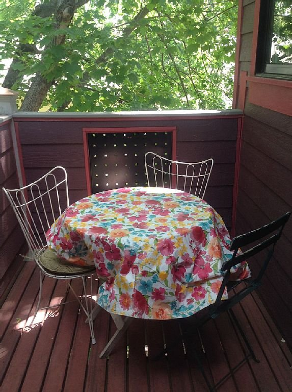 The upstairs deck has a tree-house feel.
