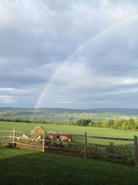 Rainbow Stretching Across Property