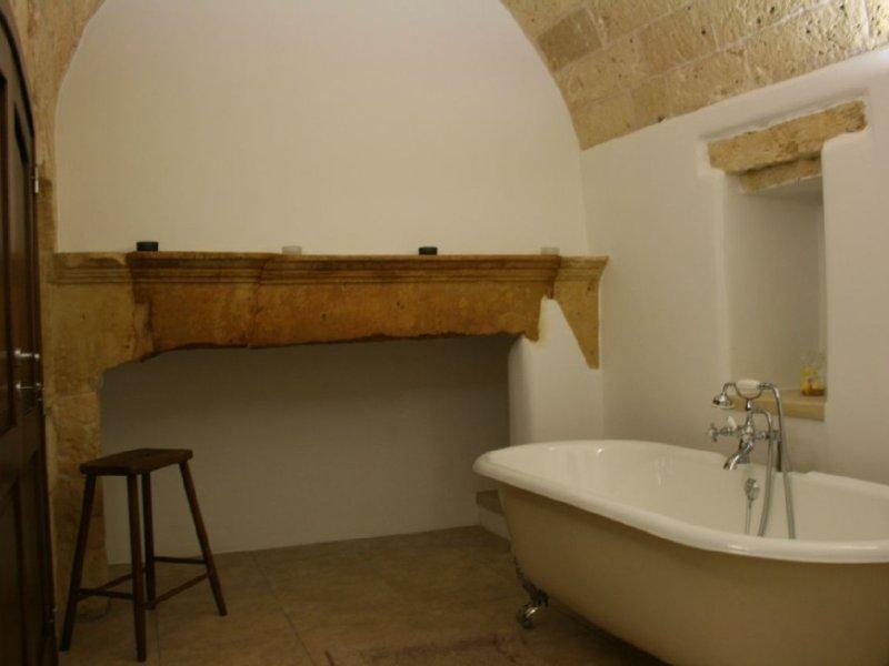 Stunning stone ceiling bathroom and claw-foot bath