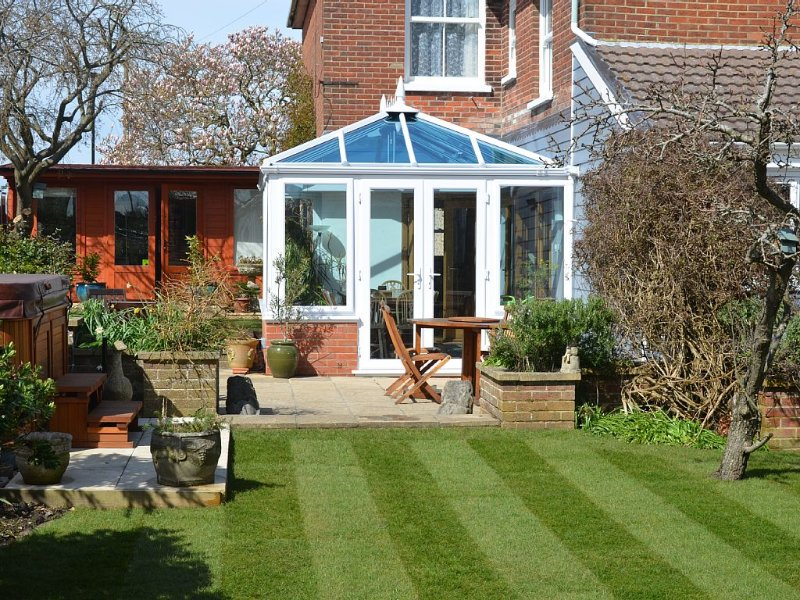 New larger conservatory and private garden