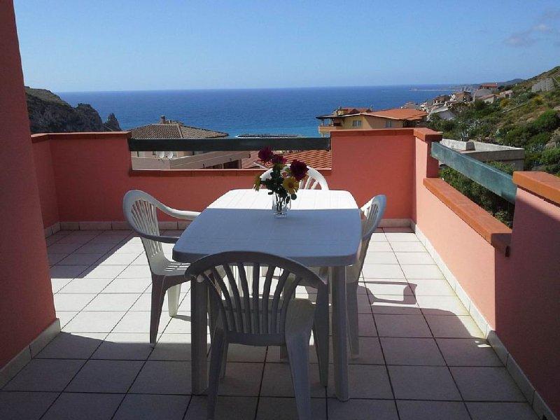 appartamento nuovo  con bellissima vista mare, vacation rental in Portixeddu