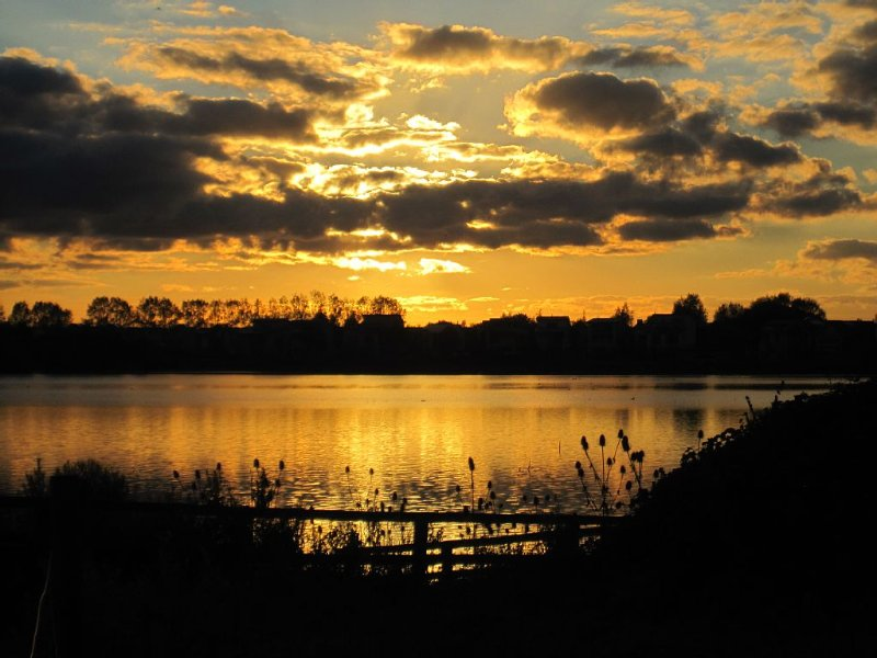 Sunset over Somerford Lagoon on Lower Mill Estate