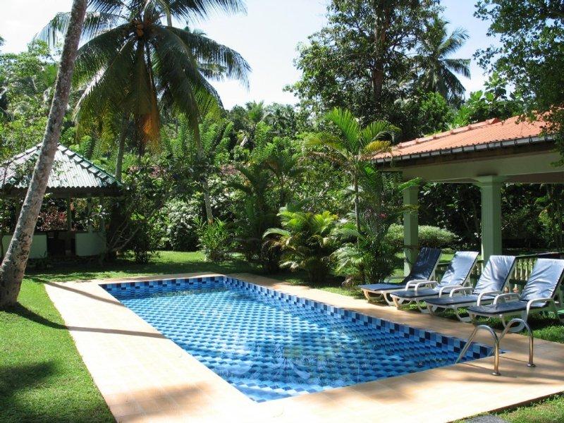 Superb villa in beautiful gardens close to beach., holiday rental in Hikkaduwa