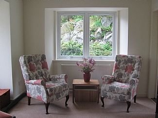 view of the sitting room into garden