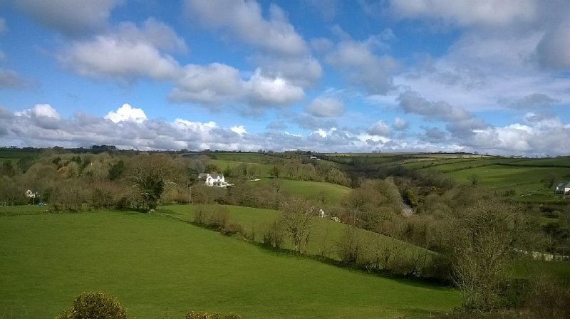 Panoramic view of countryside from bay window in lounge.