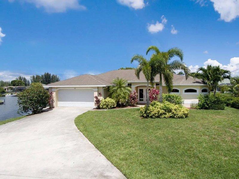 Villa Tropical Breeze, traumhafte Kanallage, SPA, Steuern inkl, Boot optional, location de vacances à Cape Coral