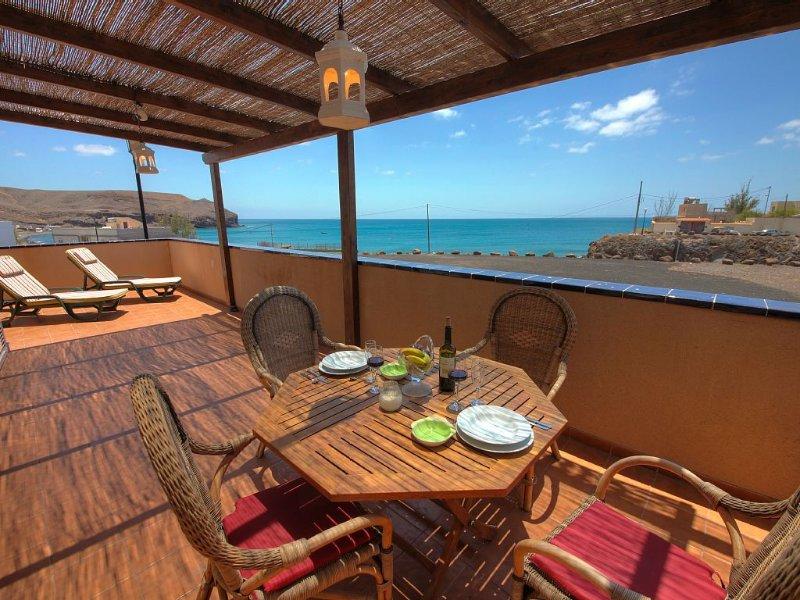 Apartment facing the sea in a romantic fishing village, holiday rental in La Lajita