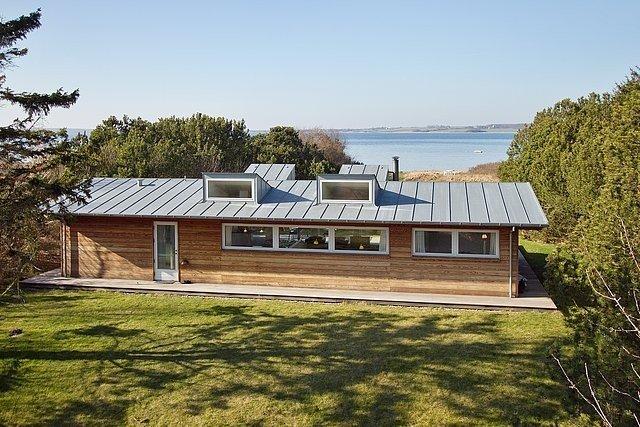 Exklusives 112m² Luxus-ferienhaus direkt am see, vacation rental in Oroe