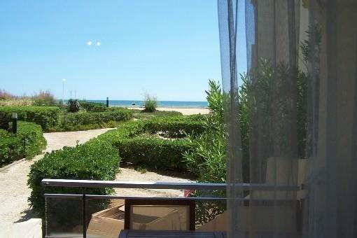 Appartement RDC Terrasse Vue Mer accès direct plage 1ère ligne Palavas, location de vacances à Palavas-les-Flots
