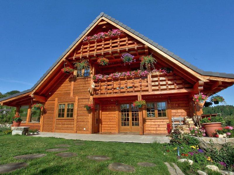 Châlet luxueux en bois avec plan d'eau privé, location de vacances à Saint-Front