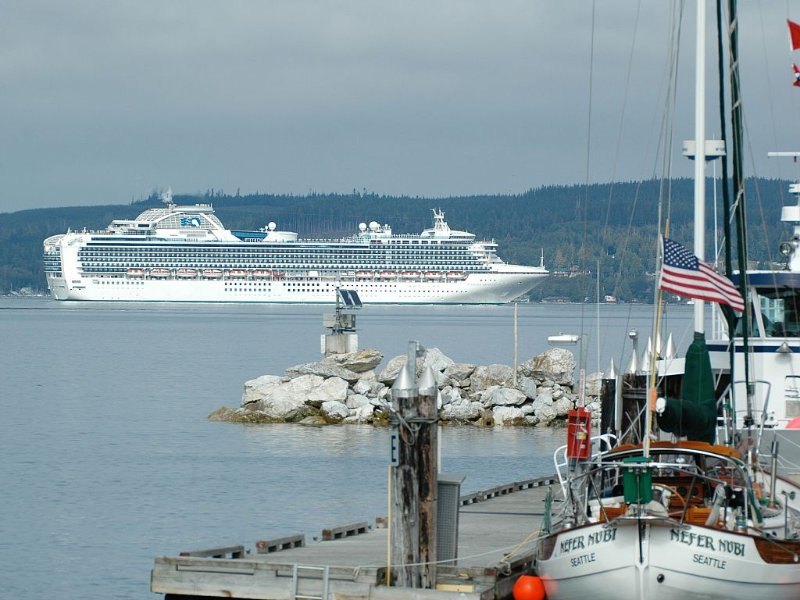 * Port Mcneill dock with a cruise ship passing by coming home from Alaska