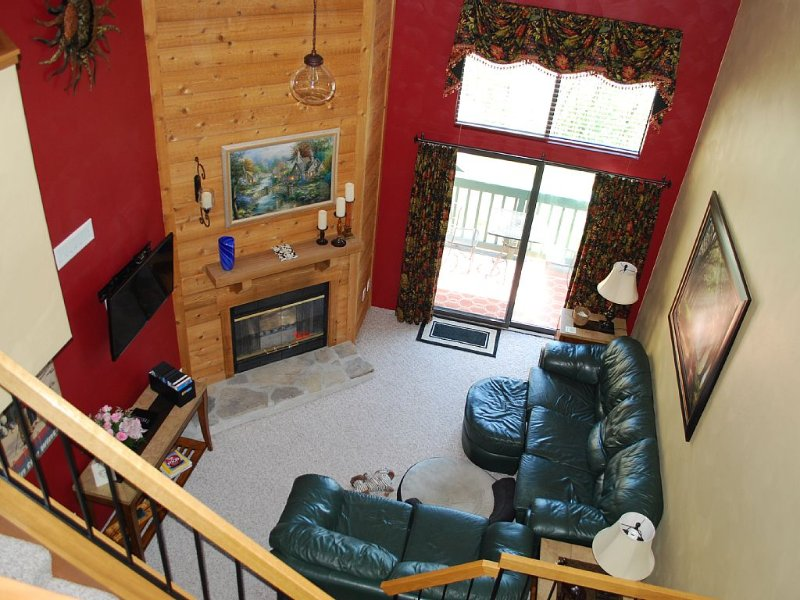 Two story living room viewed from the loft.