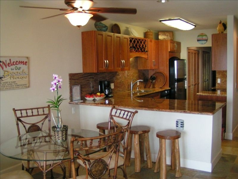 Newly upgraded kitchen with cherry cabinets and granite counters.