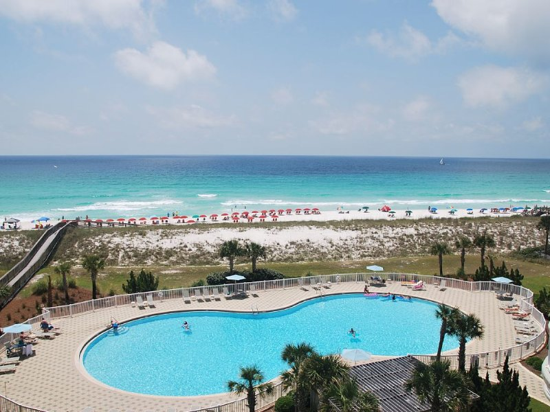 view of the pool and ocean from the balcony