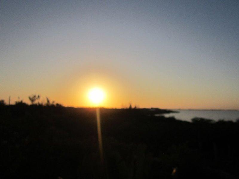 View of sunrise over Cudjoe Bay from second story balcony