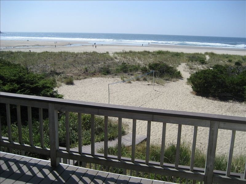 view of private volleyball court from upper deck dining area
