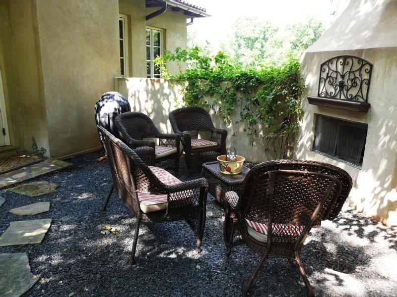 Villa Oliveti courtyard with wood burning fireplace.