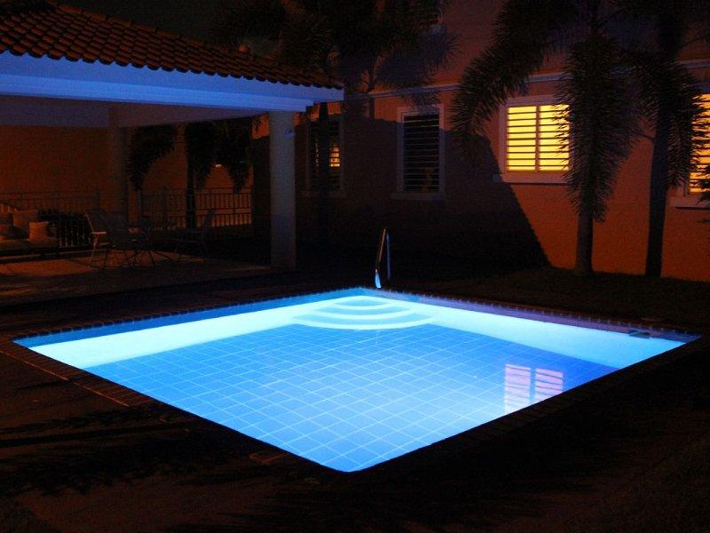 Lit up pool at night.