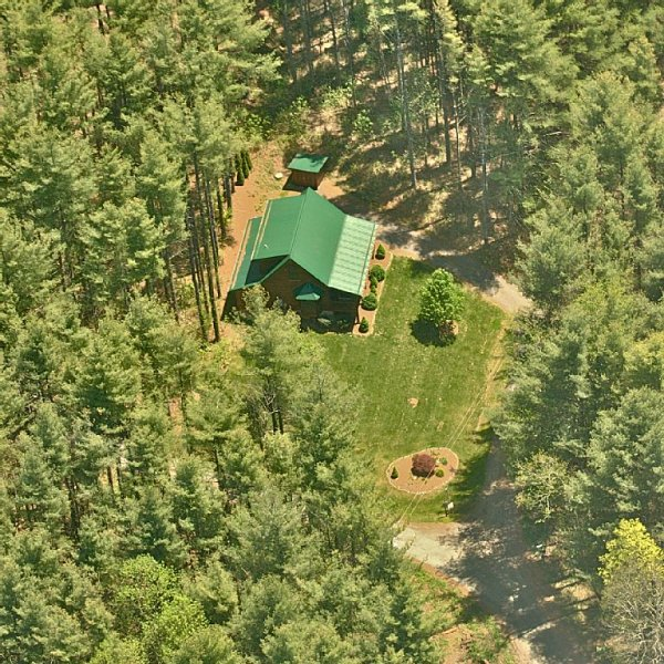 Aerial Shot of the cabin and the seclusion.