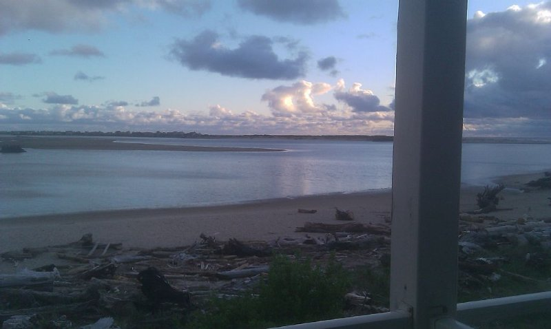 View from front  deck . There is a propane barbecue on the deck.