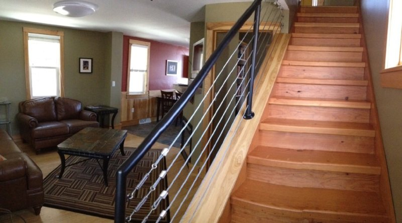 Stairway with reclaimed fir and custom/handmade railing.