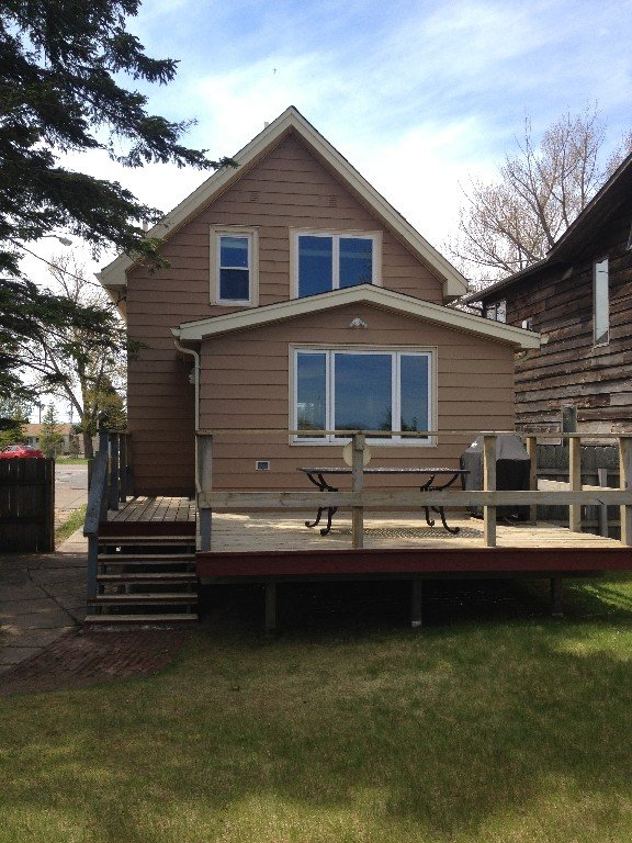 Deck, grill, and back yard.