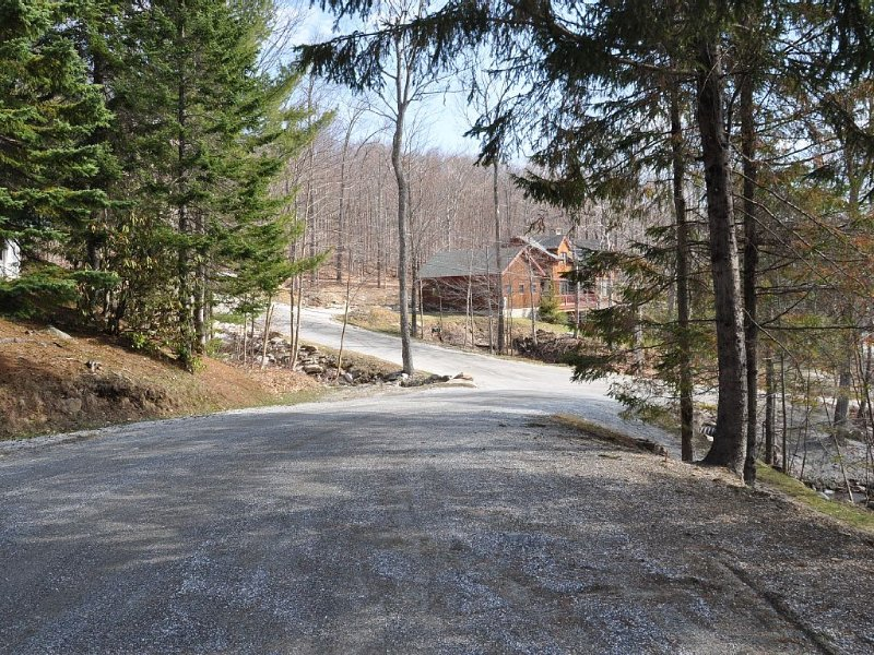 view of trail from the street in front of condo