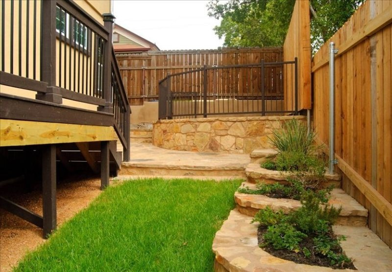 More outdoor living area beautifully landscaped and fenced in!