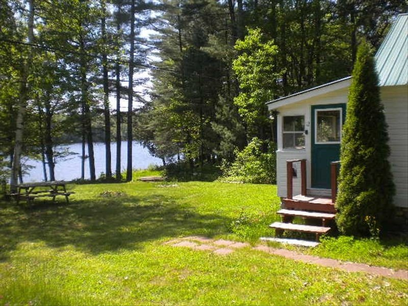 The entry way door to the cabin with view of the lake