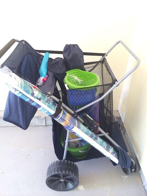 Both homes have beach chairs, umbrella, & a beach buggy with beach toys!