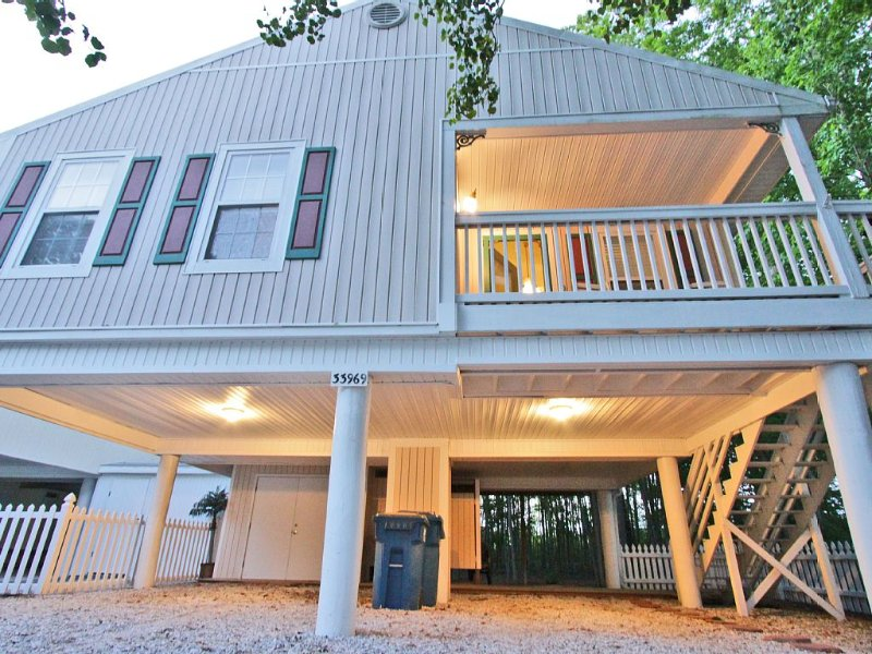 Bahamas beach style cottage on stilts. Parking underneath and in driveway.