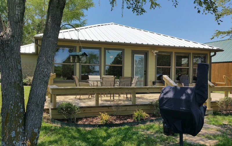 Beautiful lake views from the outdoor deck with table, chairs and charcoal grill