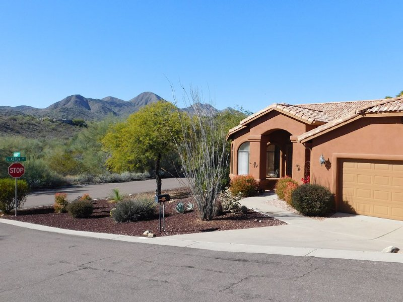 McDowell Mountains and open desert wash across the street with walking trails