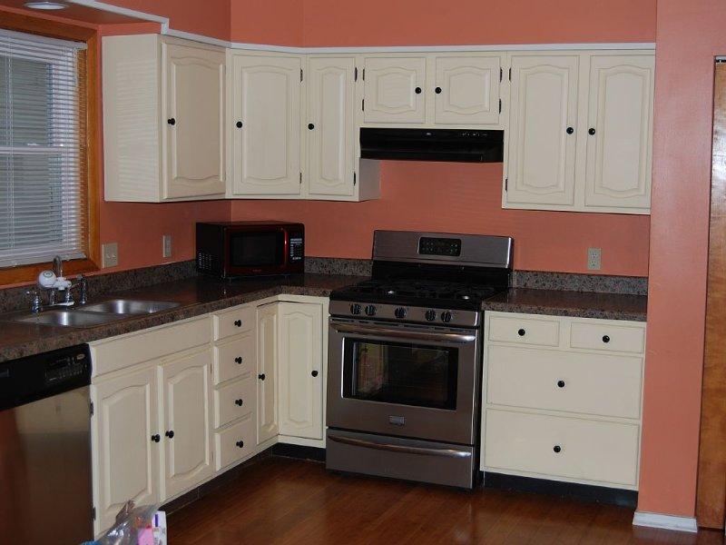 Large kitchen with gas range & full size refrigerator