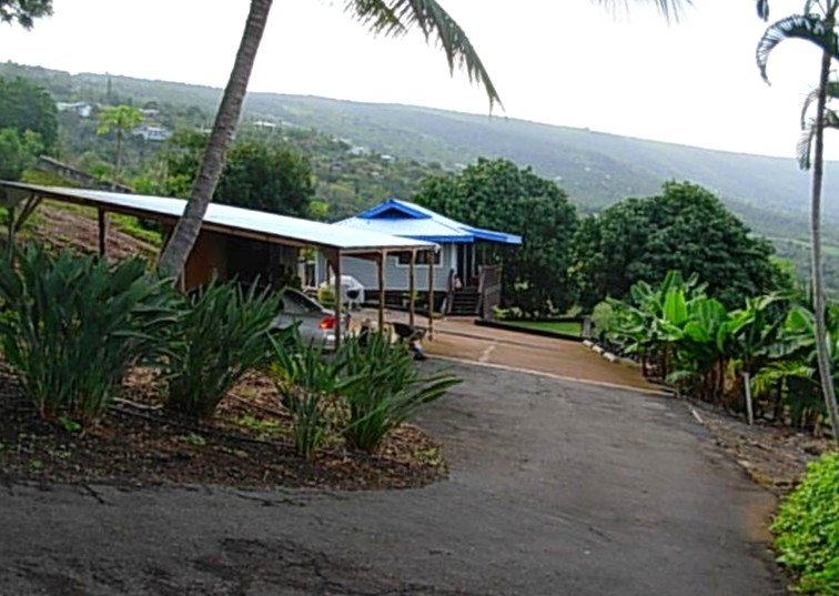 Quaint Hawaiian Cottage on 5 Acres., location de vacances à Captain Cook