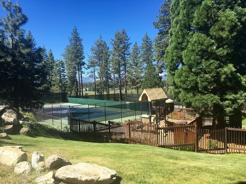 Tennis courts and play area at Lake Village