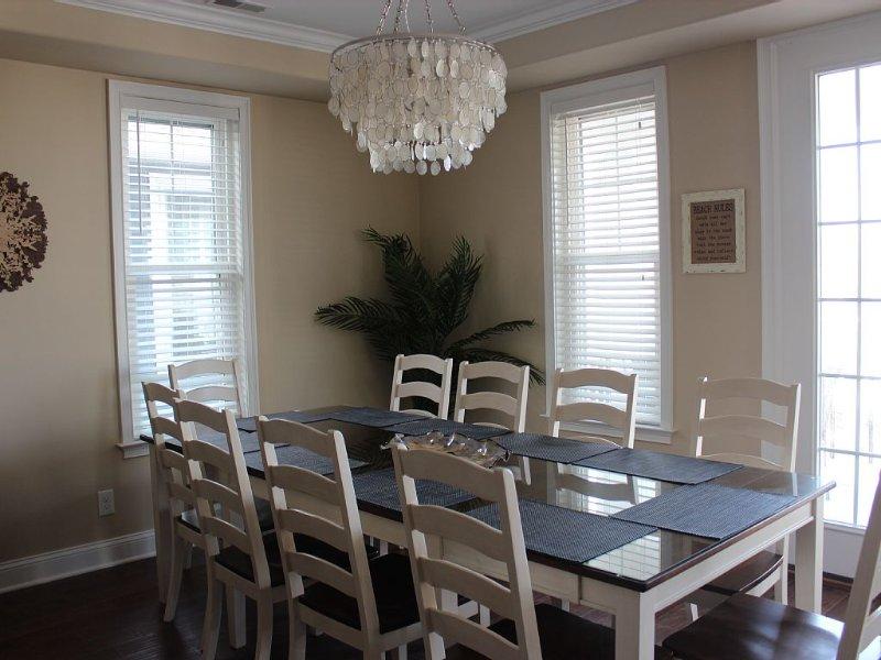 Large dining area seats 10 plus 4 stools at kitchen island