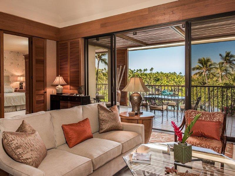 Luxurious living room opens to lanai