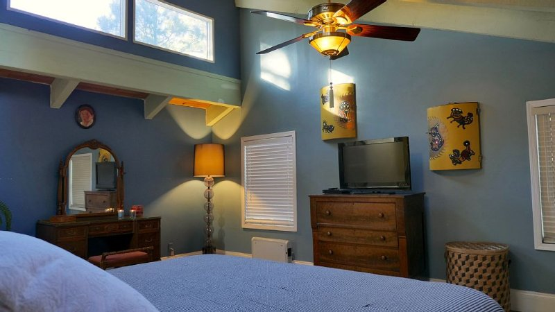 The master includes a HD TV and blue ray player, desk, dresser, and skylights.