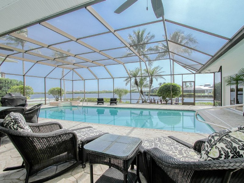 Waterfront View In Every Room- Open Layout- 3 Bedroom Remodeled House On The Pt, vacation rental in Bonita Springs