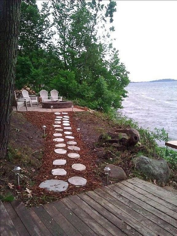Lakeside tranquility. Enjoy the fire pit while relaxing on Adirondacks chairs.